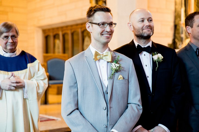 groom seeing bride walk down the aisle for the first time