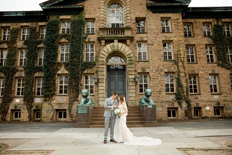 wedding photos at princeton university campus in front of the main entrance