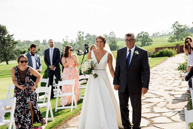 bride with dad at ceremony