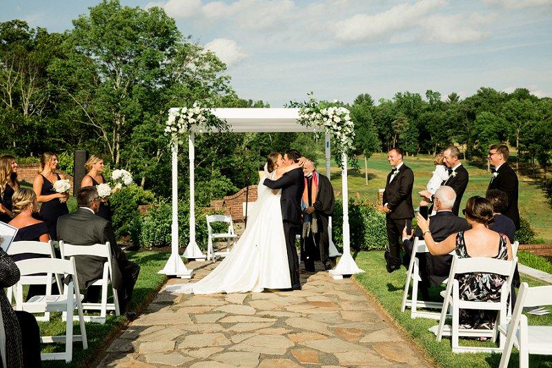 first kiss summer wedding at hamilton farm golf club