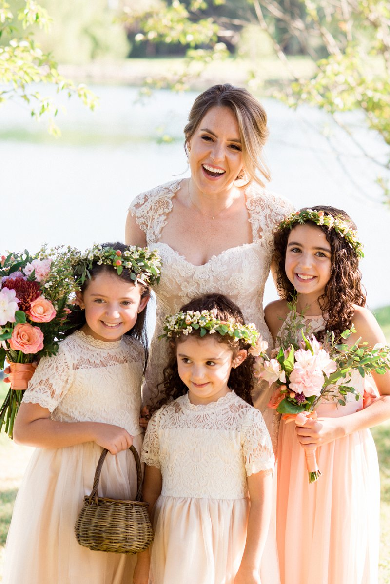 candid photo of bride and flower girls